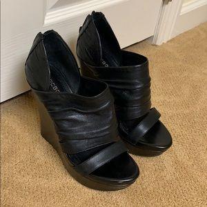 BCBG Black Leather Wedges